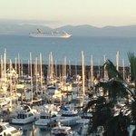 Carnival Ship passing Hotel Coral & Marina