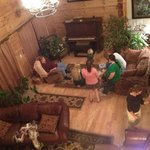 Gathering in the downstairs living room, near the piano, the lovely fireplace is on the other si