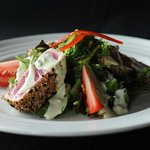 SESAME TUNA steak, pan seared rare, over mixed greens