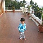 kid enjoying big balcony