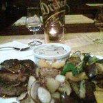 Beefsteak with Diana cream, brandy, onion & mushroom sauce. sides: steak potatoes & grilled vegg