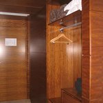 lovely wooden closets, with a safe and fridge