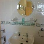 Little sink in corner of non en-suite room