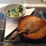 Confit of duck cassoulet with wilted greens and a Parmesan crb - divine!