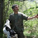 Matteo Bartolini, his truffle dog Sole, and a truffle.