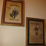 Classic tango sheet music covers on the walls.