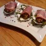 Fried oysters wrapped in coppa with truffle oil