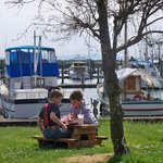 Kids picnicking along Ilwaco Marina.