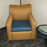 The funny stiff chair with the blue cushion