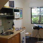 Room with kitchenette small bar fridge and 2 seater table