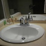 Bathroom sink with amenities