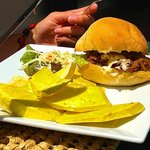 Wild pig burger with breadfruit
