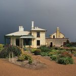 Highfield House with storm coming