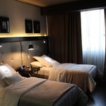 Room with triple single beds