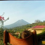 rocking chair on the front porch of the room, view of Arenal