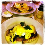 Nearest is Eggs Florentine and other is Eggs Benedict