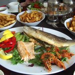 Hot fish platter - Sea bass, trout and giant prawns