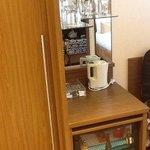 minibar/fridge in each room with coffee and tea