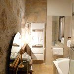 Really modern bathroom in a medieval setting.