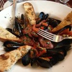 mussel and sausage appetizer.