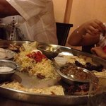 Lovely food served in a huge plate to be eaten by 3-4 people!