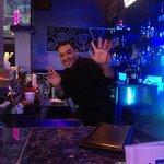 Adrian tending bar