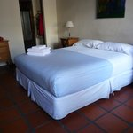 Very comfortable bed in large room overlooking courtyard