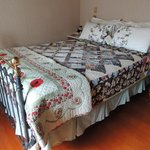 Another room with beautiful quilt