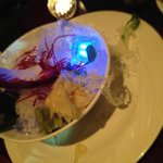 The sashimi bowl was served over ice with a glowing ice cube