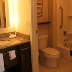 bathroom- door between sink and toilet, shower area