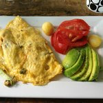 Omellete made to order and avocado with tomato and pineapple balls. Coffee excellent too!