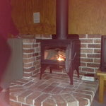 Fire place in cabin, take note of the wall colour