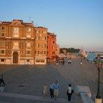 The setting sun highlights Venetian architecture around Giardini