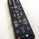 TV remote control with many channels as well as movies on HD
