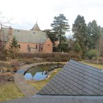 Birdfeeders, a small waterfall and a pond at one end of the large garden, and neighboring church
