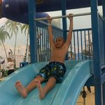 My son on the pool slide. FUN...FUN...FUN!!!