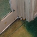 corroded door jam leading to pool/ stained carpet right side