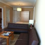seating area and bed area in room 304