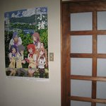 Ryokan adorned with pictures from the anime.