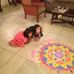 Children enjoying the Diwali decorations in the living room