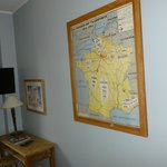 The room had an old map on the wall, very cute