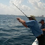Capt Jeff removing weights from line to enable reeling in fish