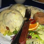 Breaded filet stuffed with shrimp, octopus and scallops with cheese sauce