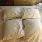 Goofy little pillows - who does this?