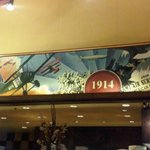 Aviation history mural surrounds the main dinning room, with a ceiling done as an old hangar roo