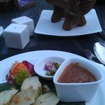 Chicken sate with rice cake steamed in banana leaf