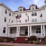 This is a view of the hotel front porch.  Room 415 is the gabled window on the left atop the hot