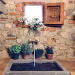 antic stone sink in Melograno kitchen