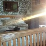 Sun streaming across bed in the room.