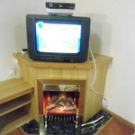old school TV with fire (rustic pine lodge 3)